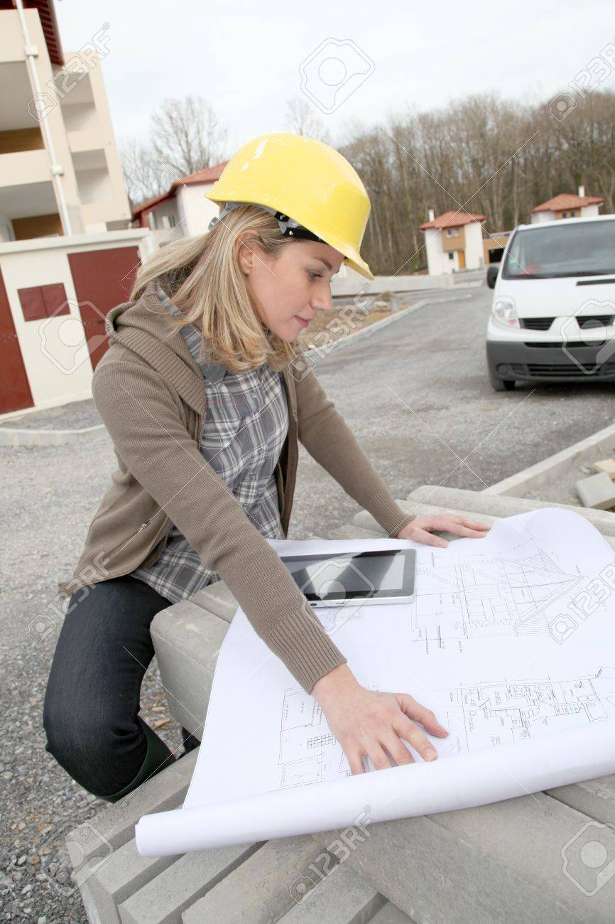 Woman engineer looking at plan on construction site Stock Photo - 8974300