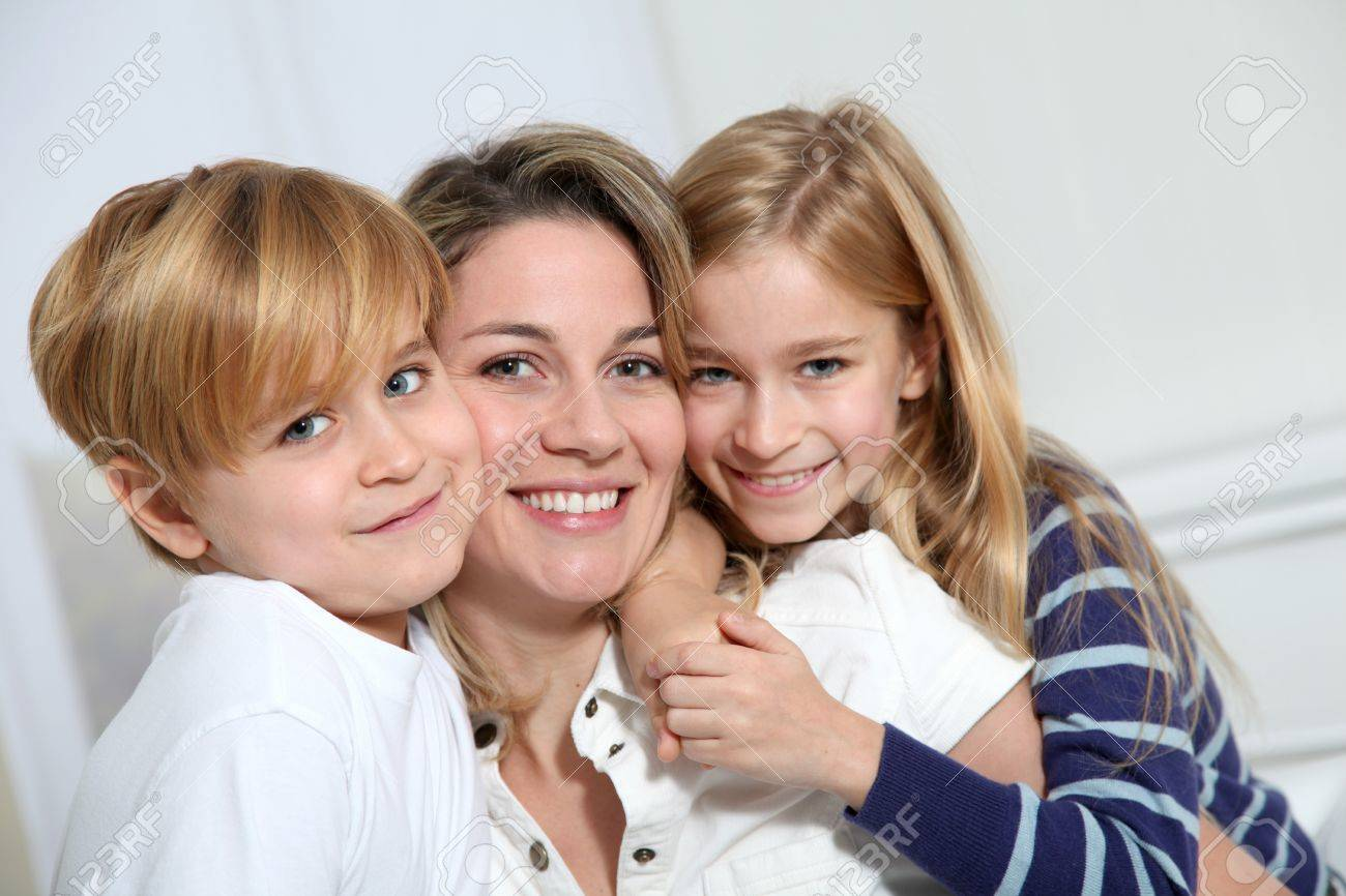 portrait of happy mother with 2 blond children Stock Photo - 8973086