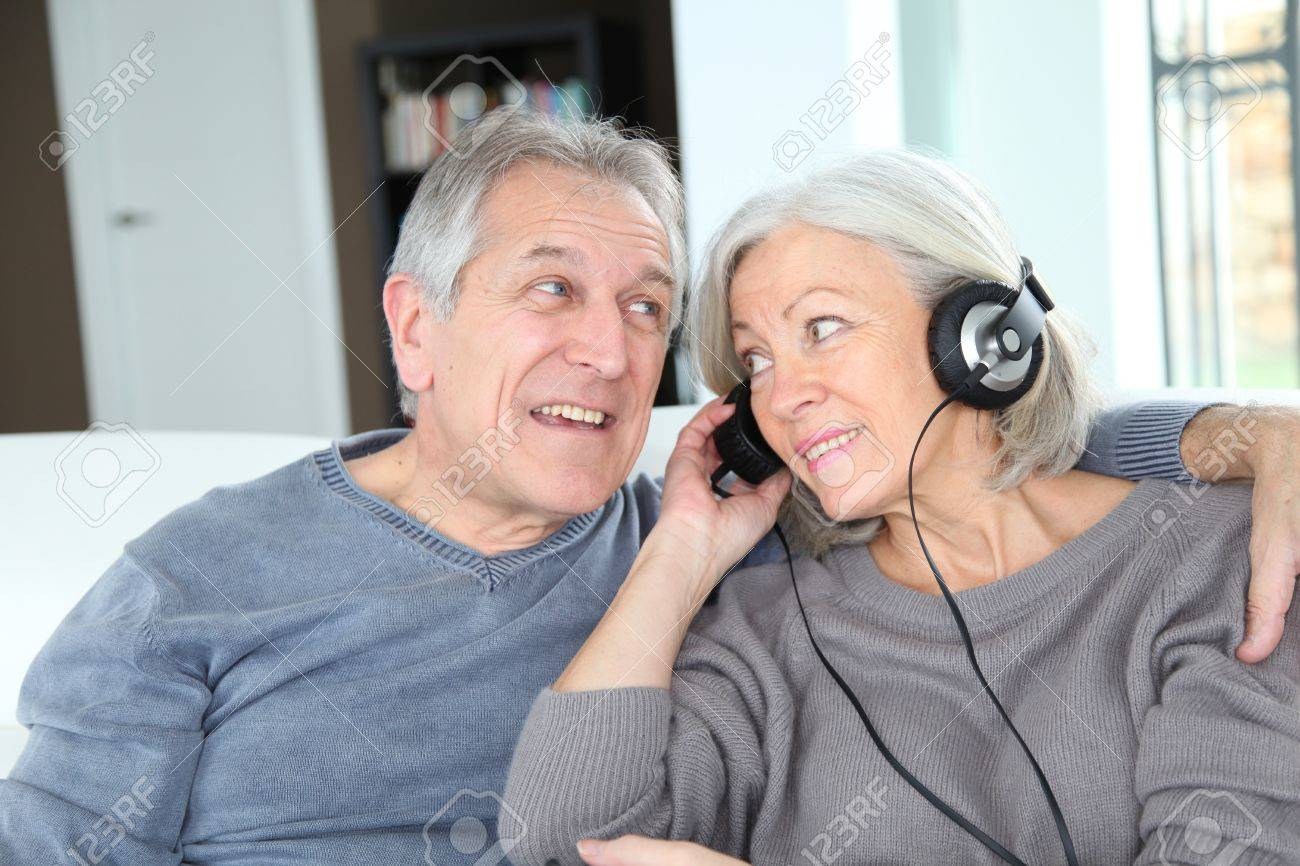 Senior couple listening to music with headphones Stock Photo - 9172146