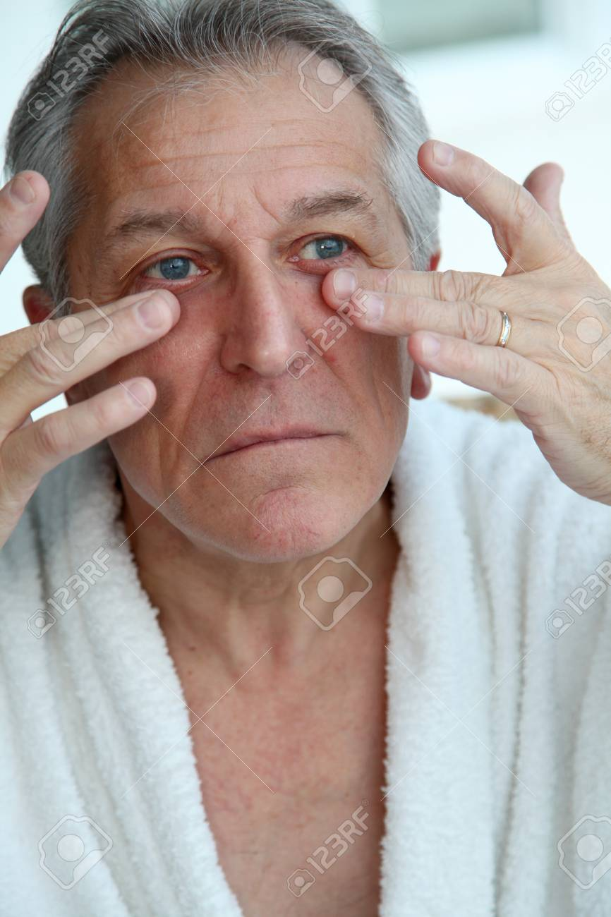 Senior man doing a face massage Stock Photo - 9065113
