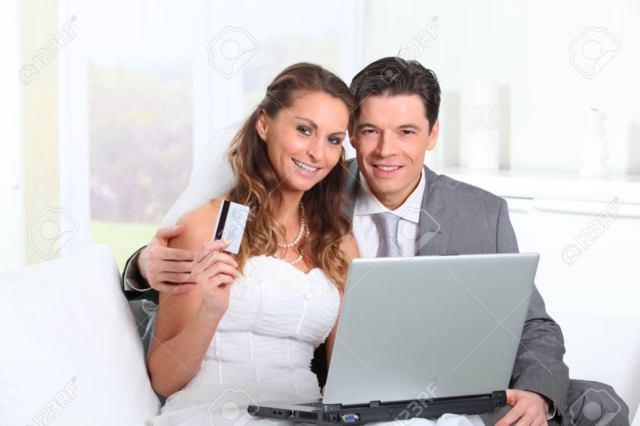 Bride and groom doing shopping on inernet at home Stock Photo - 9002098