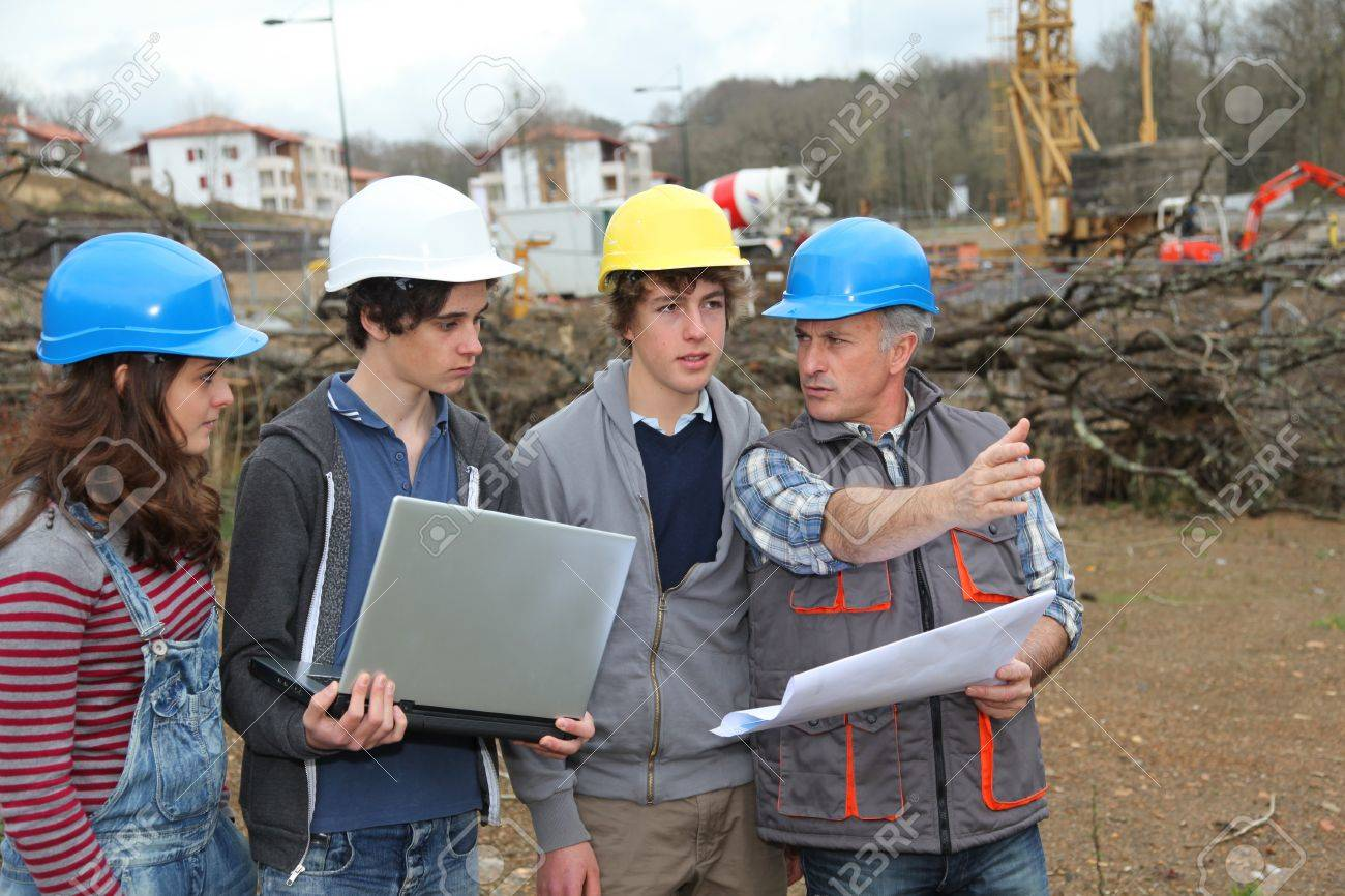Adult with group of teenagers in professional training Stock Photo - 9010178