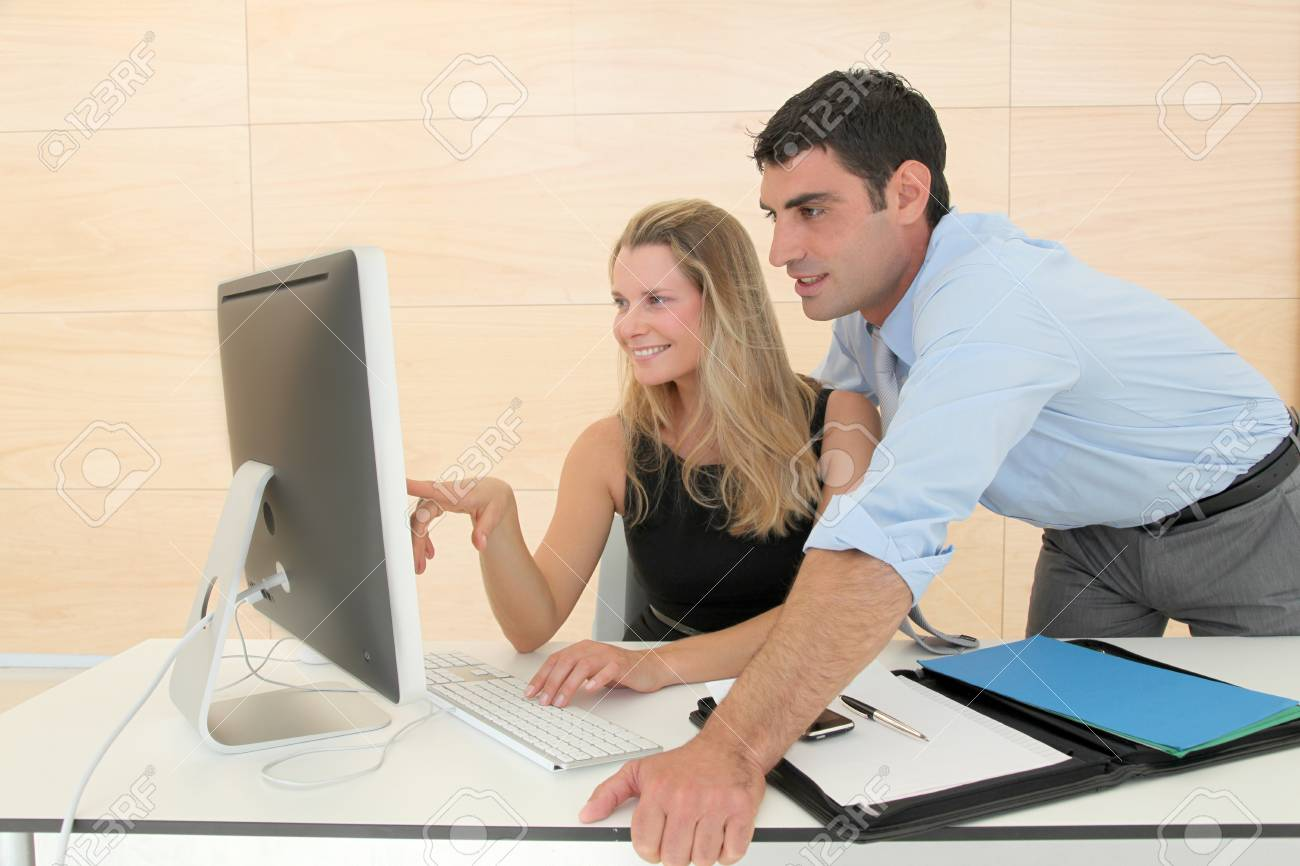 Business people in office working on computer Stock Photo - 9347371
