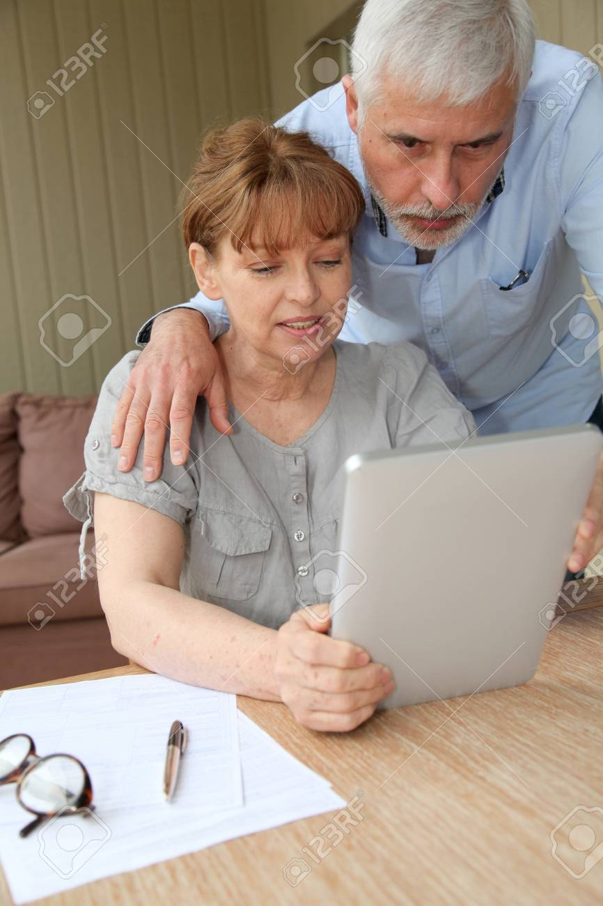 Senior woman using electronic tablet at home Stock Photo - 9479839