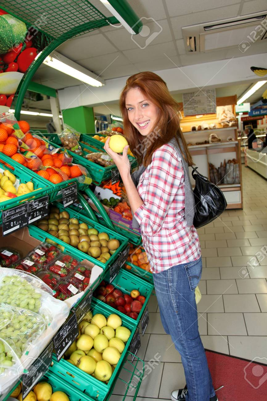 Woman at the grocery store buying fruits and vegetables Stock Photo - 9480393
