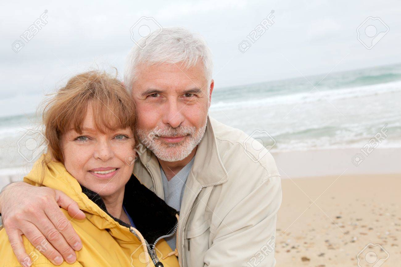 Senior couple at beach on a cloudy day Stock Photo - 9479101
