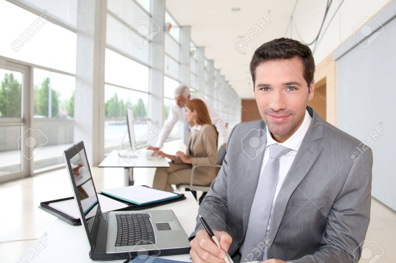 Businessman working on laptop computer Stock Photo - 9480580