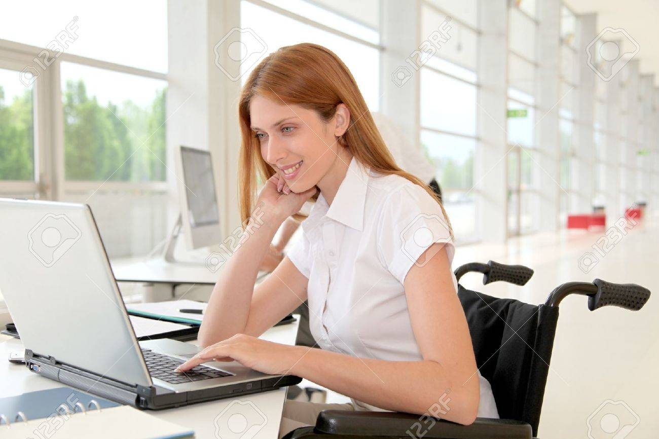 Handicapped woman in office Stock Photo - 9480469