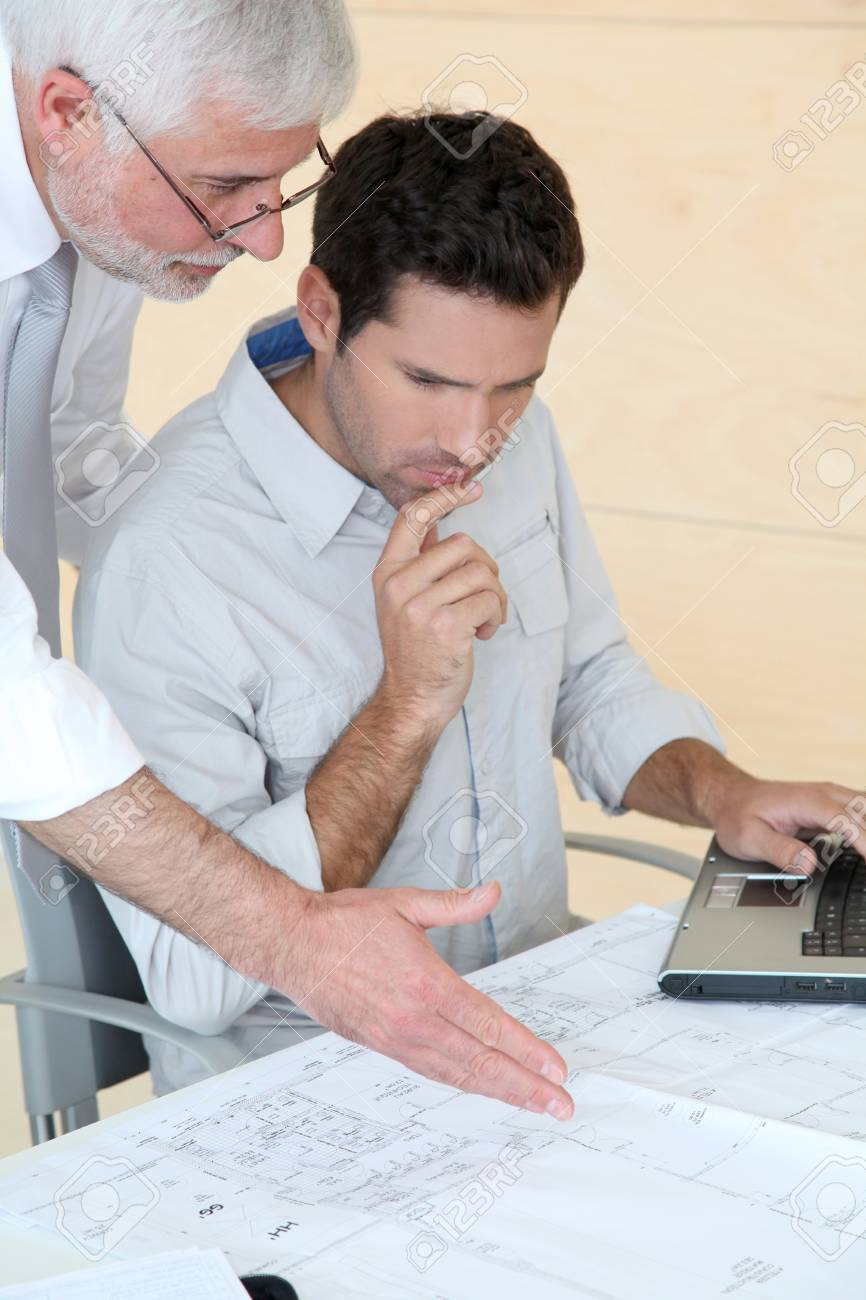 Architects working on planning Stock Photo - 9480772