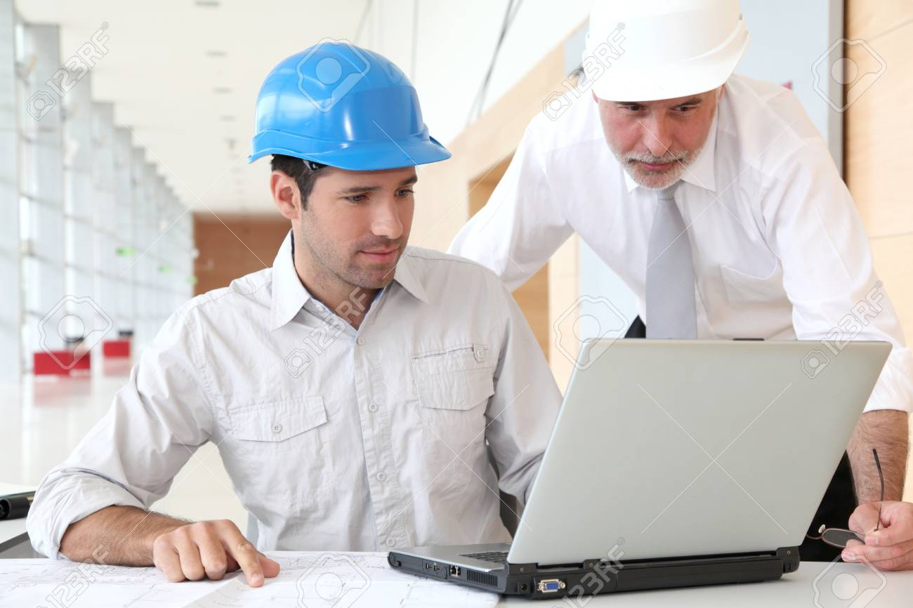 Architects working on planning Stock Photo - 9480736