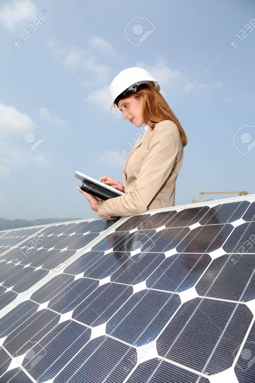 Woman engineer checking solar panels setup Stock Photo - 9480815