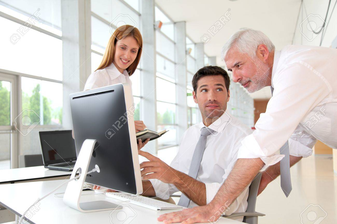 Office workers with manager in a meeting Stock Photo - 9634712