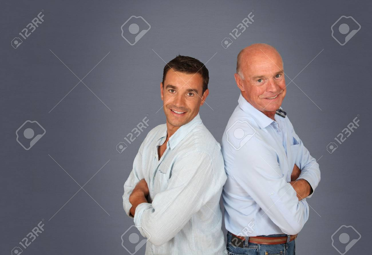 Portrait of father and son on grey background Stock Photo - 9903376