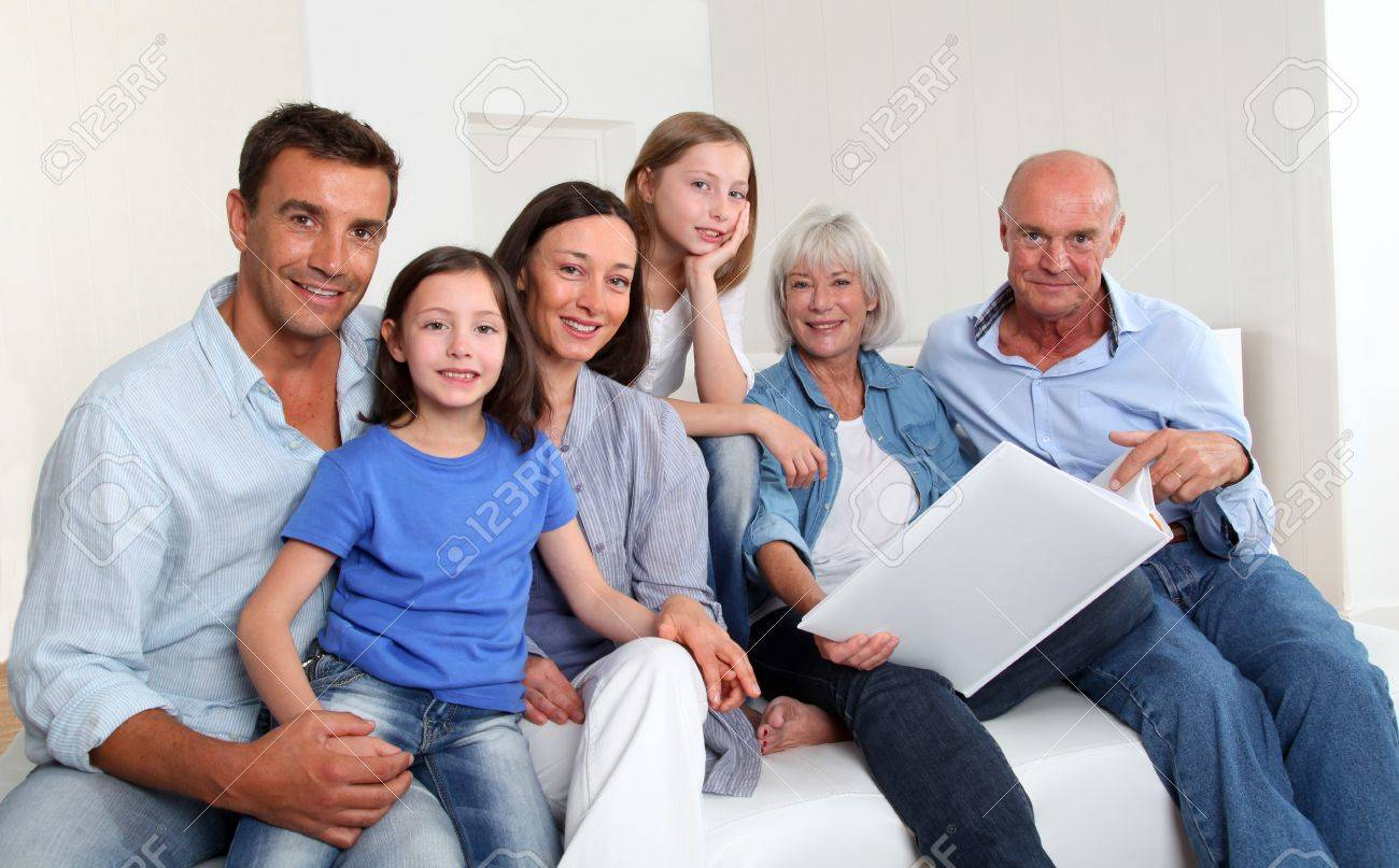 3-generation family looking at photo album Stock Photo - 9903778