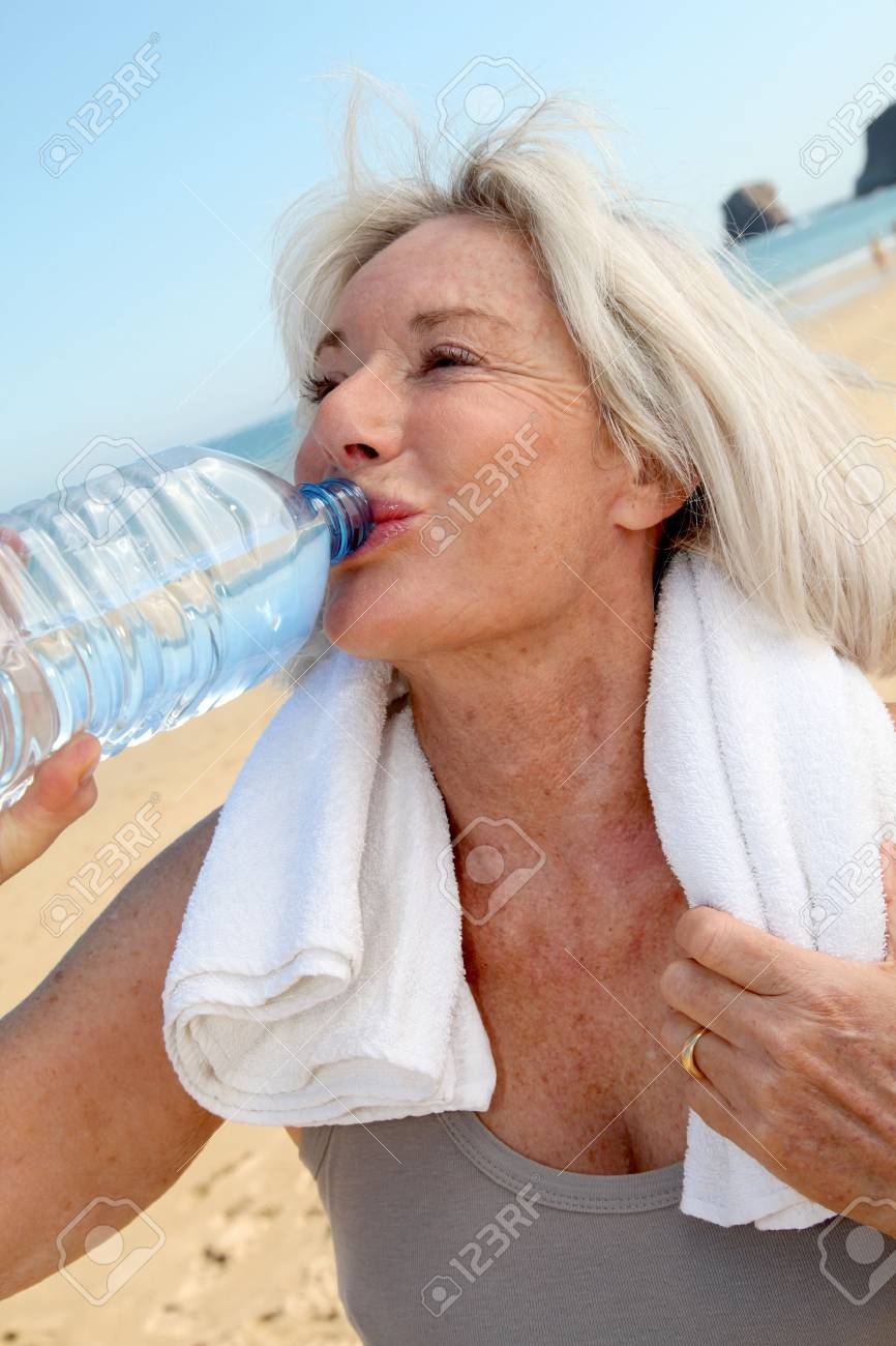 Portrait of senior woman drinking water Stock Photo - 9909485