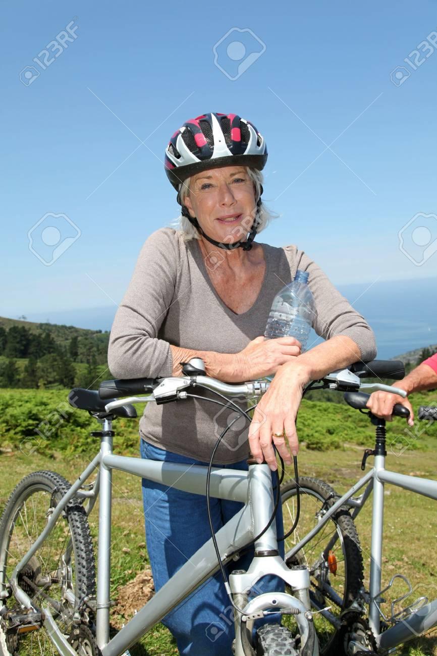 Portrait of happy senior woman on mountain bike Stock Photo - 9903373
