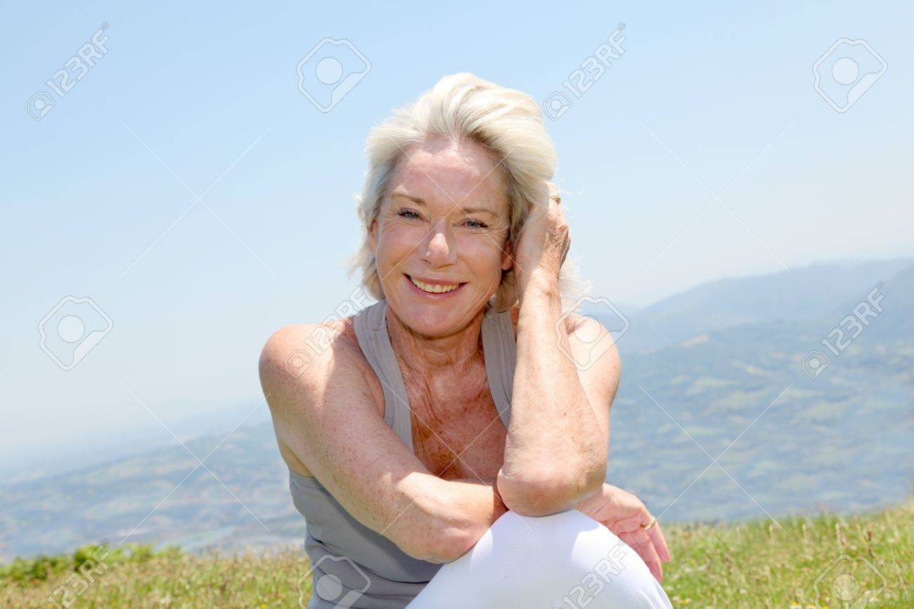 Portrait of cheerful senior woman in natural landscape Stock Photo - 9902562