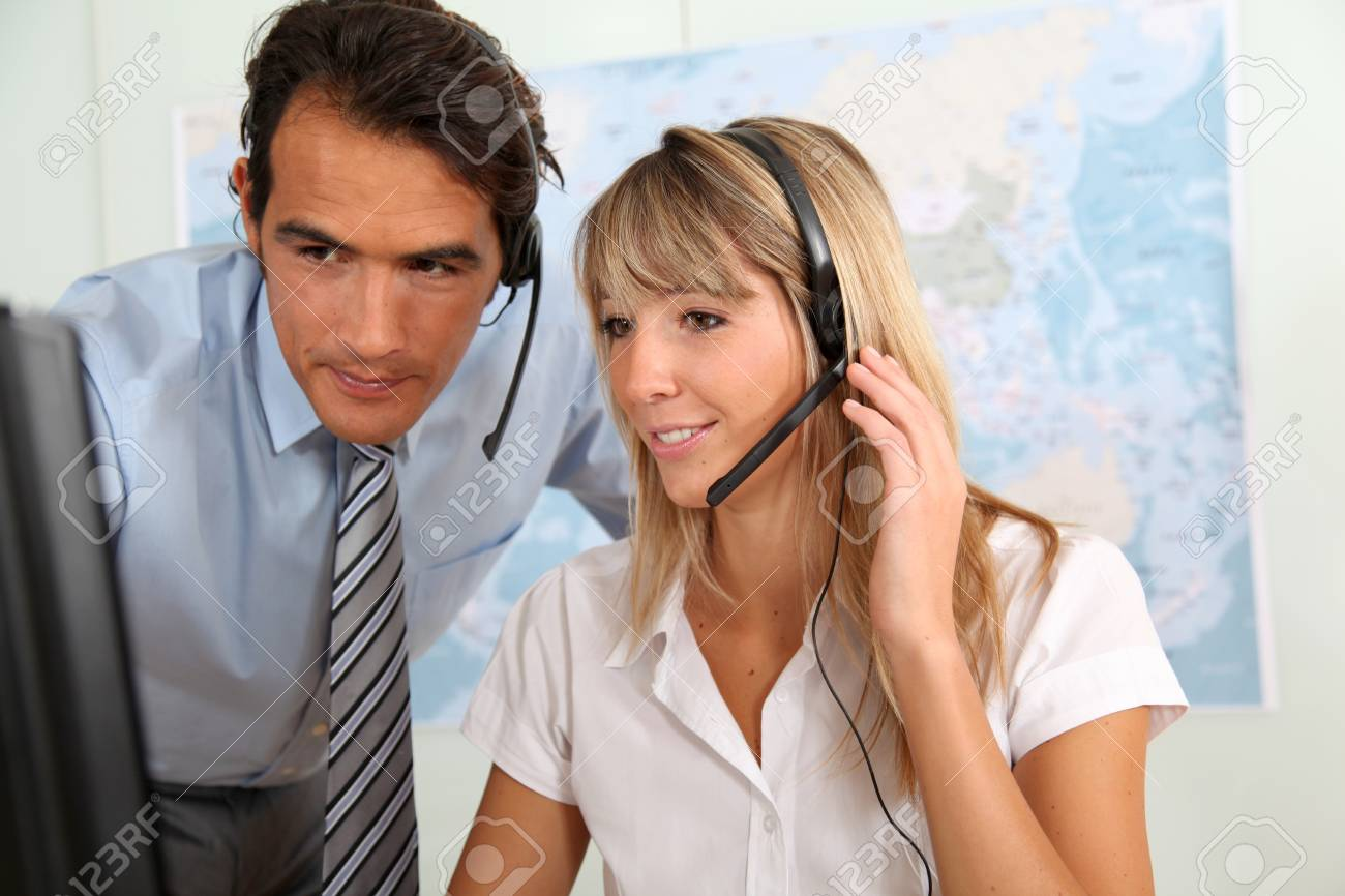 Woman and sales manager in office with headset on Stock Photo - 9903697