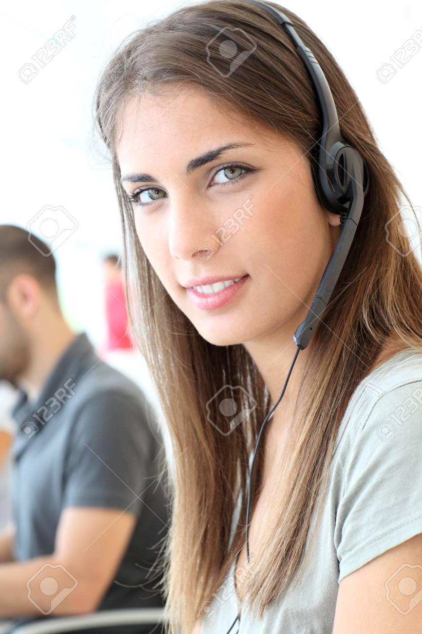 Portrait of customer service woman with headphones - 10013581