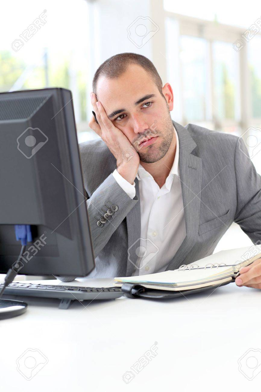 Portrait of exhausted businessman in office Stock Photo - 10013659