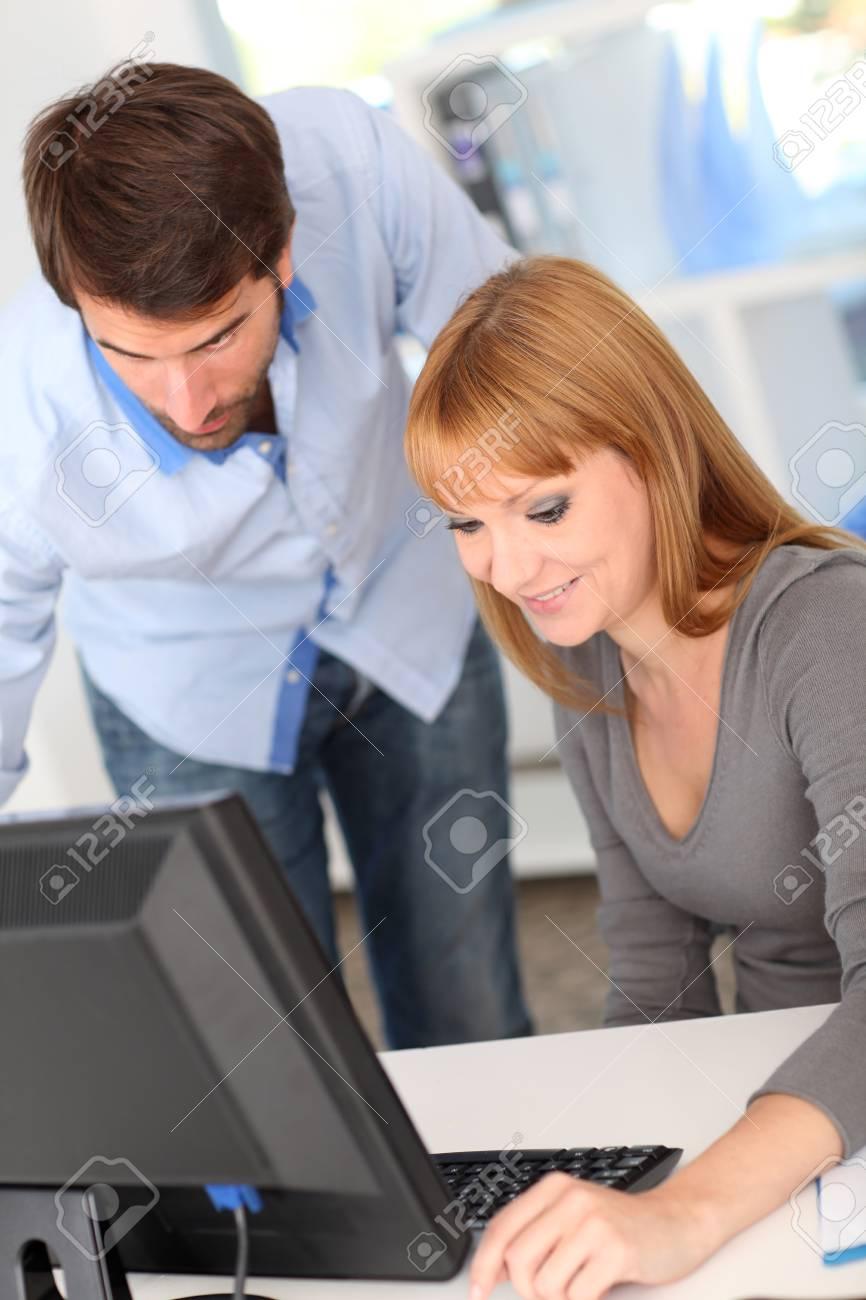Business people working on desktop computer Stock Photo - 10784629