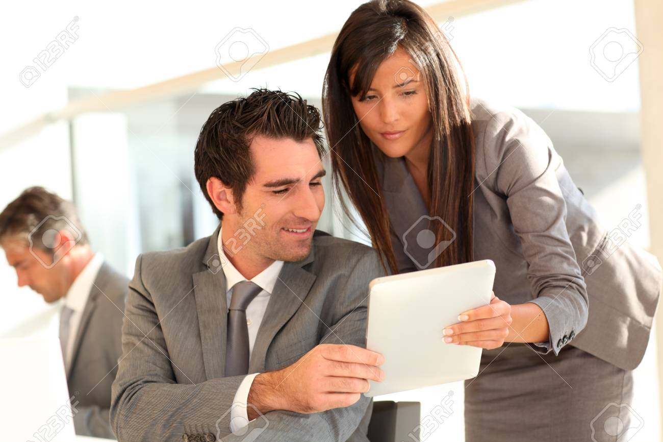 Business team using electronic tablet at work Stock Photo - 10978911