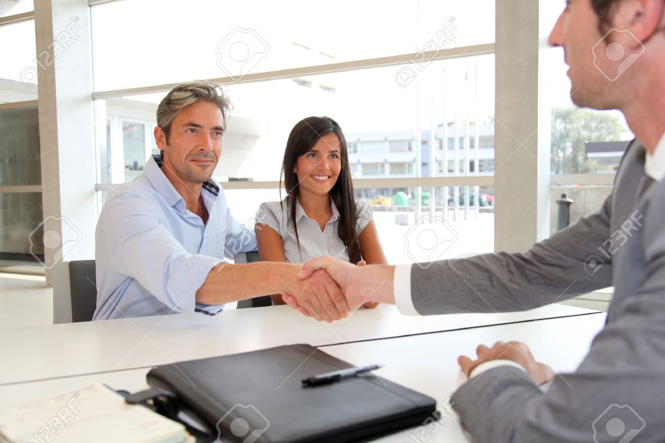 Man giving handshake to real-estate-agent Stock Photo - 10978852