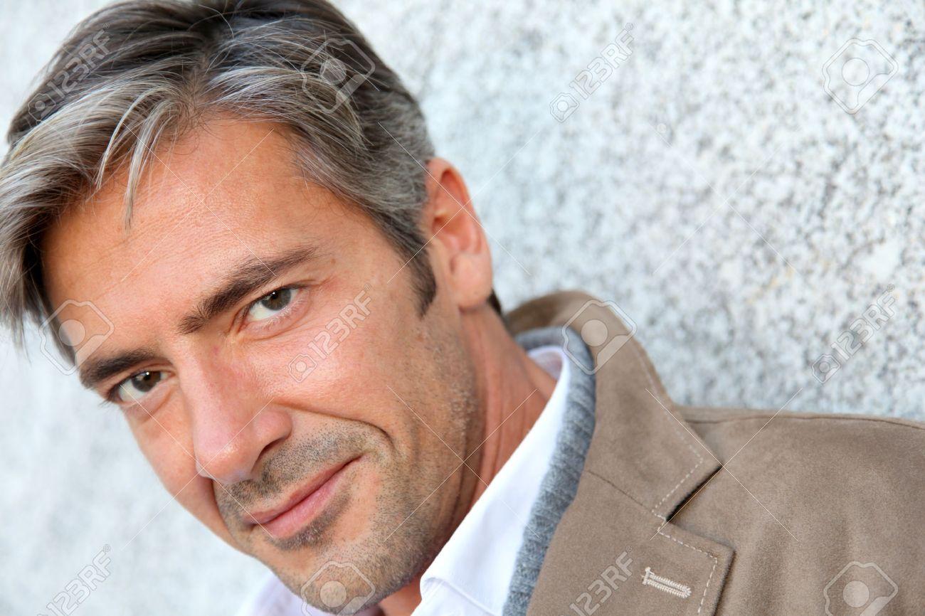 Portrait of handsome mature man in town Standard-Bild - 10979016