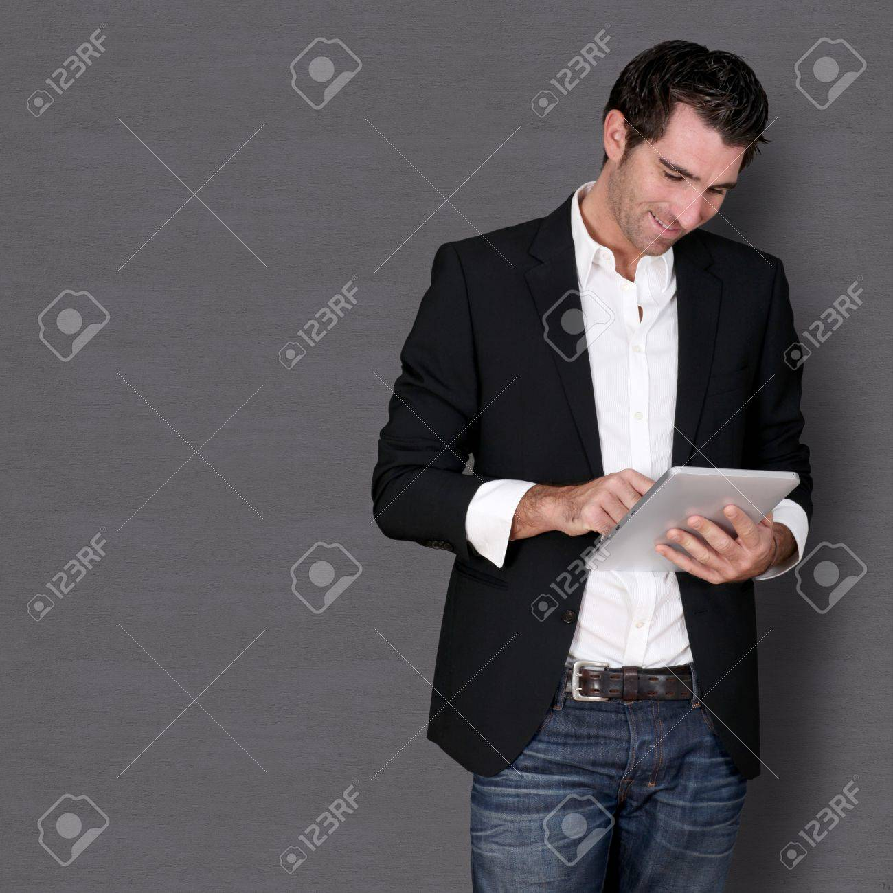 Smiling man standing on dark background Stock Photo - 11283823