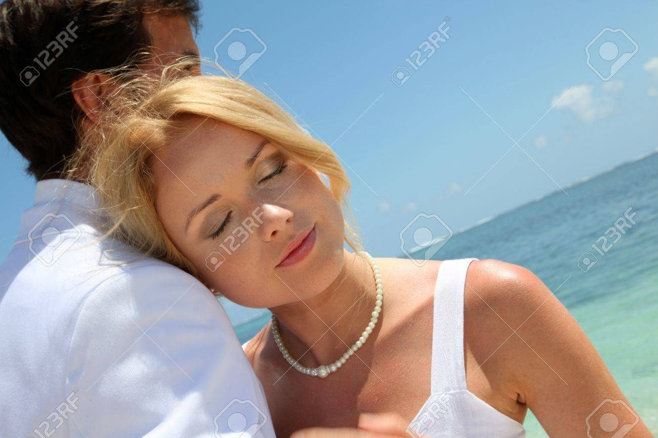 Bride and groom embracing by the sea Stock Photo - 11283684