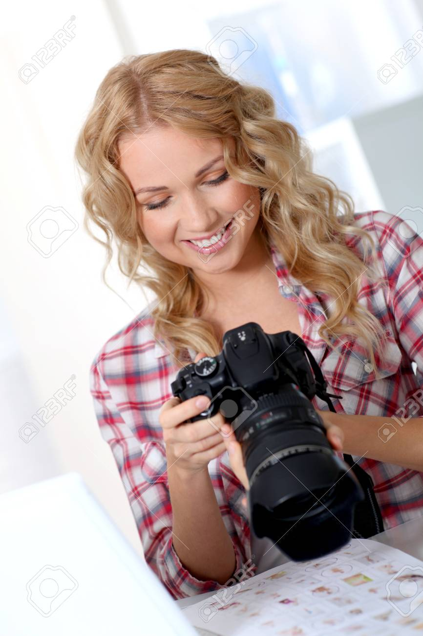 Photographer looking at photo camera Stock Photo - 11614980