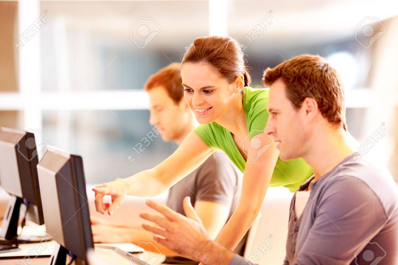Group of young people working on computer Stock Photo - 12556649