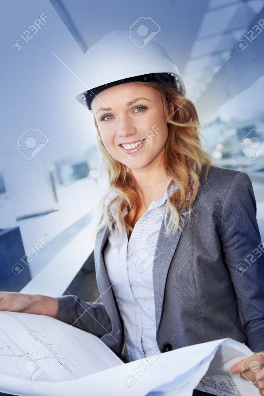 Portrait of beautiful woman architect looking at plan Stock Photo - 12556876