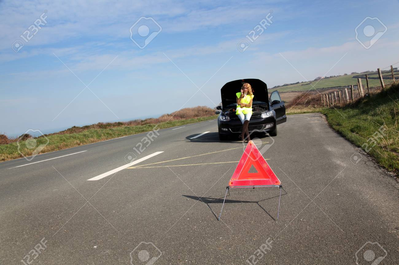 Warning triangle set on the road by broken down car Stock Photo - 12556782