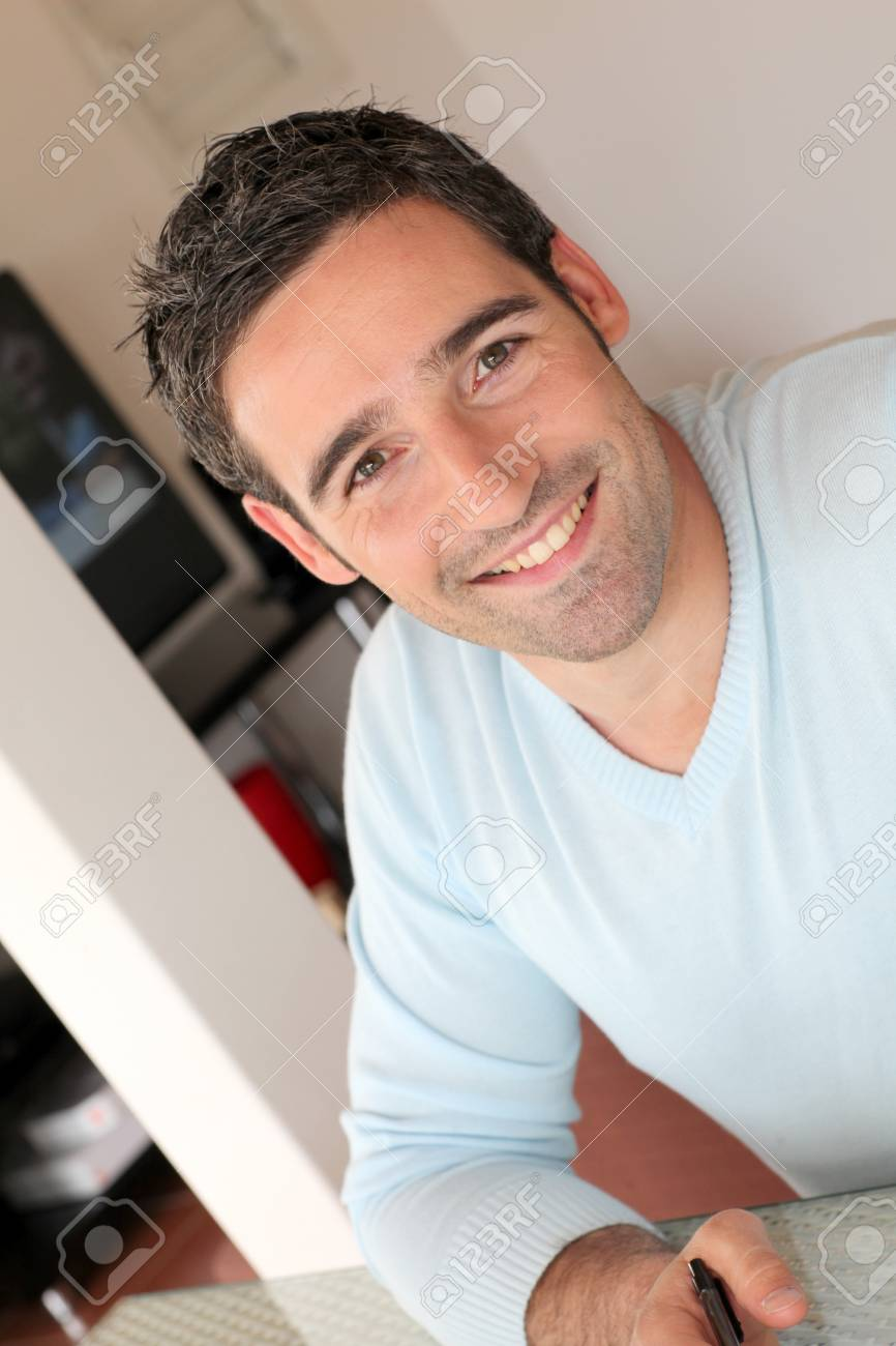 Portrait of smiling man working from home Stock Photo - 13030677