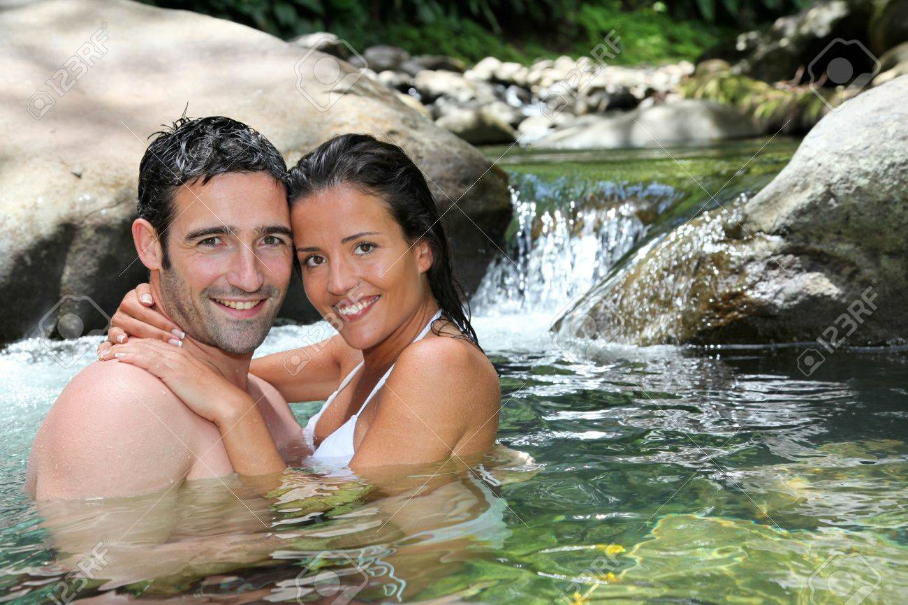 Closeup of cheerful couple bathing in river Stock Photo - 13123875
