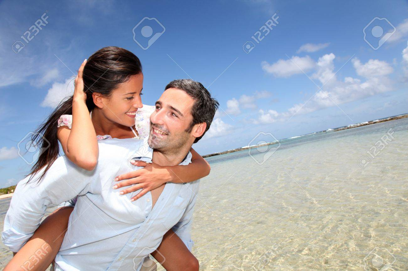 Lovers enjoying sunny day at the beach Stock Photo - 13123550