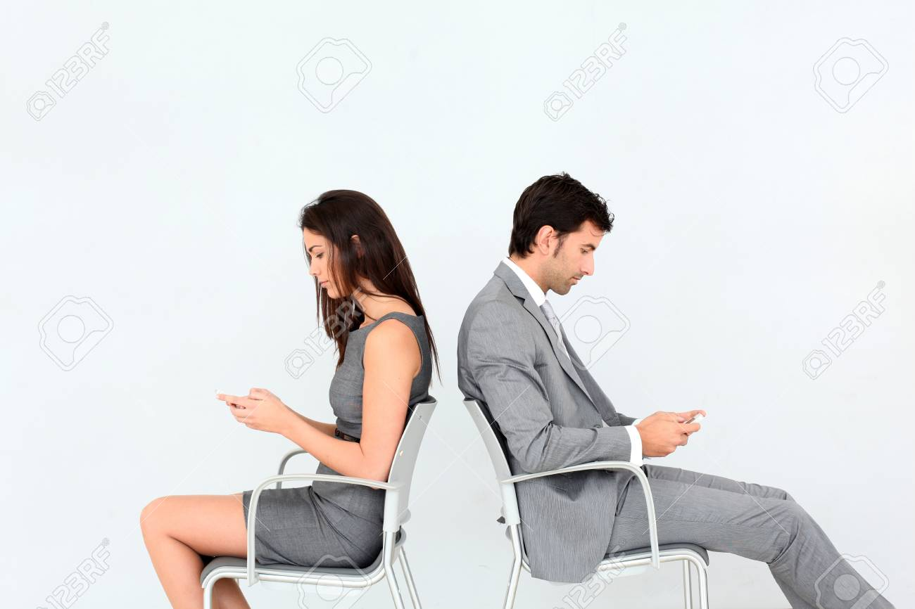 Business people sitting in chairs with mobile phone Stock Photo - 13262836