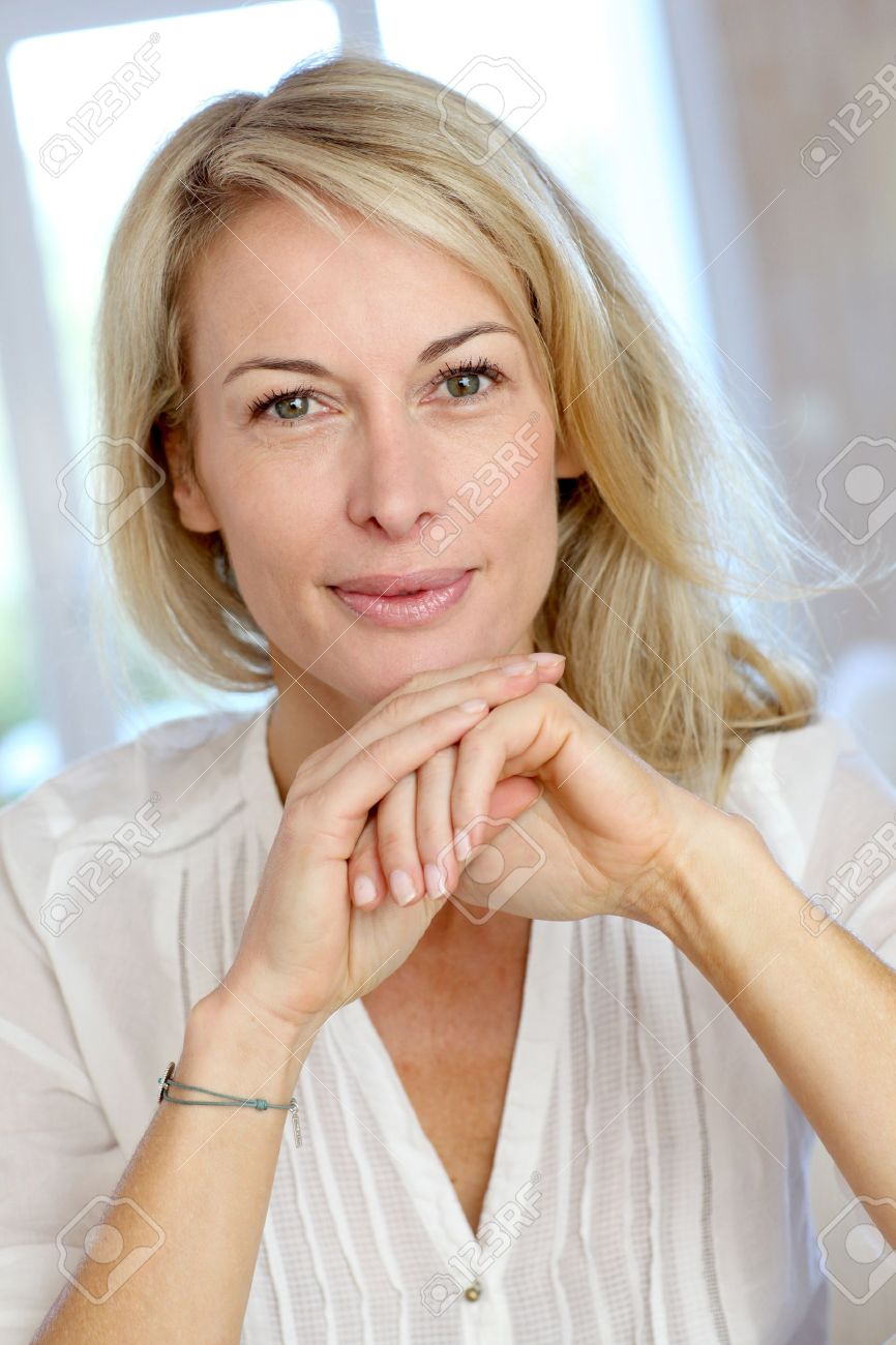 Portrait of blond mature woman relaxing in sofa Stock Photo - 13904813