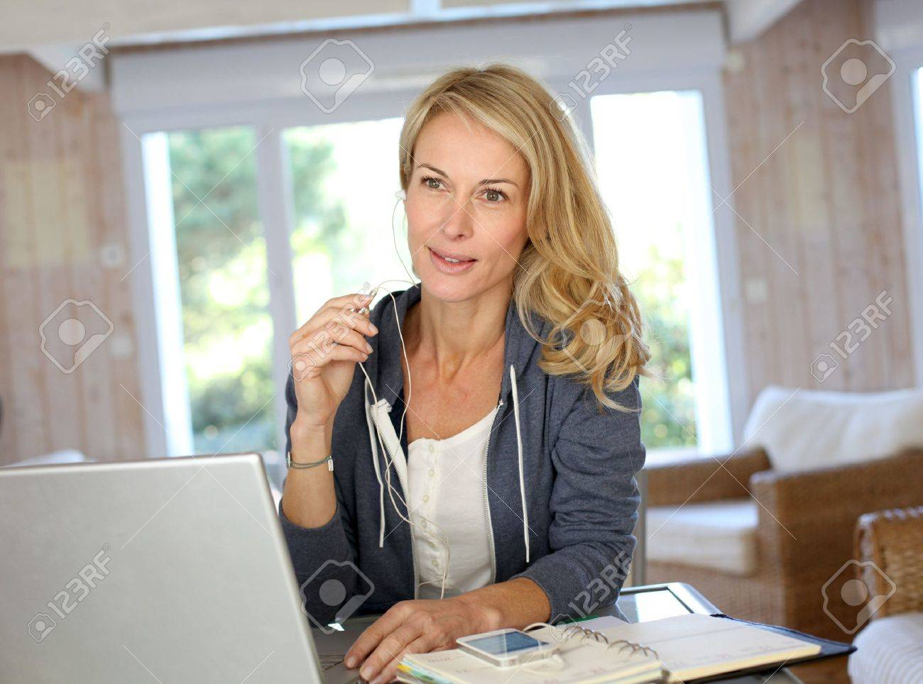 Attractive middle-aged woman working at home Stock Photo - 13904590