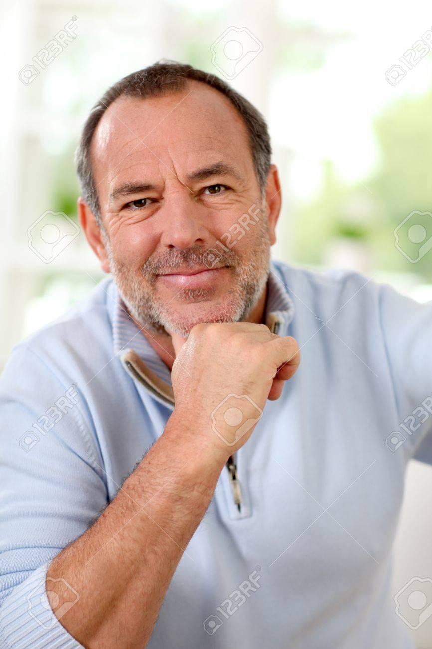 Portrait of senior man sitting in sofa at home Stock Photo - 14022852