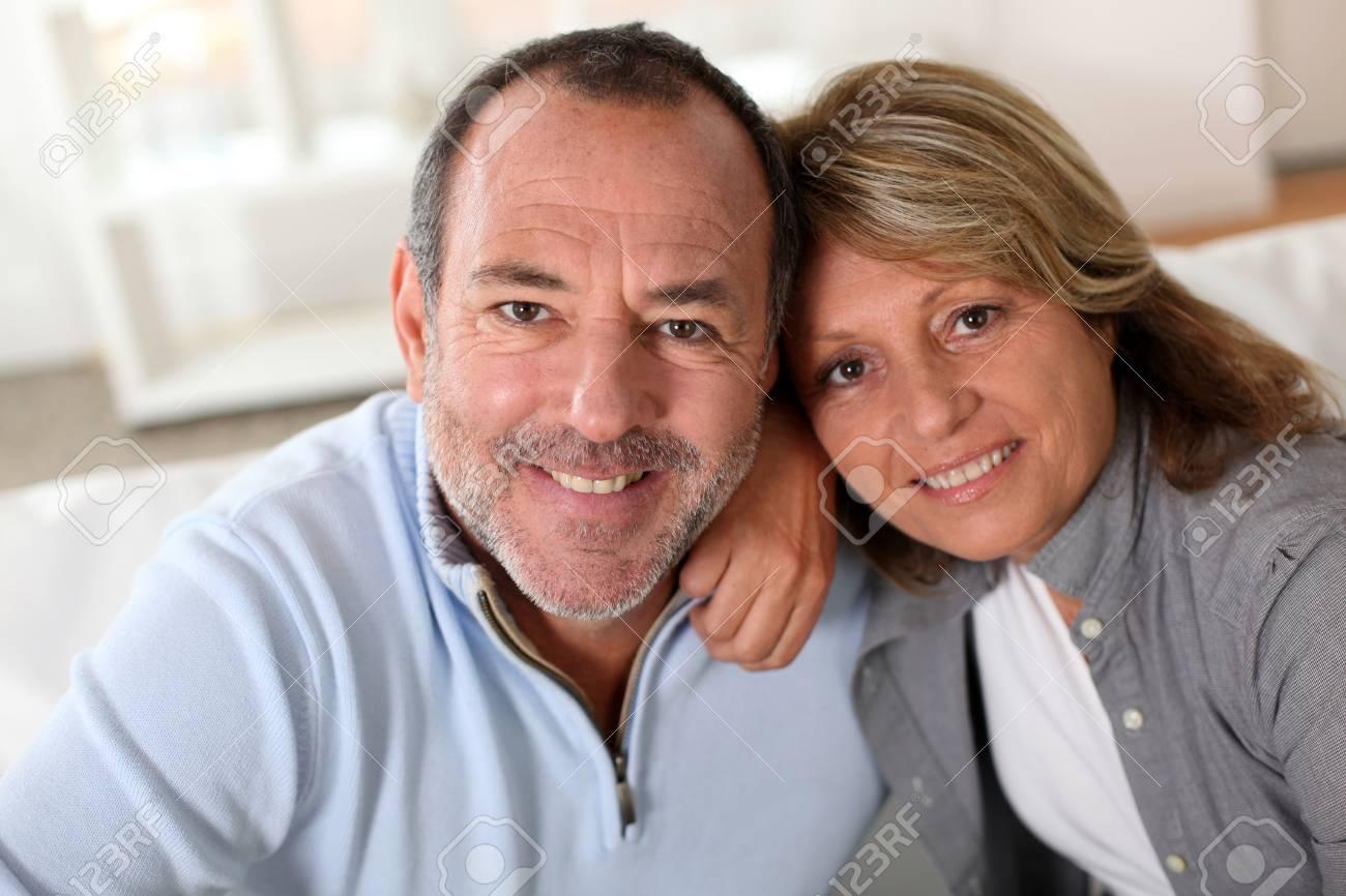 Portrait of happy senior couple sitting in sofa Stock Photo - 14023814