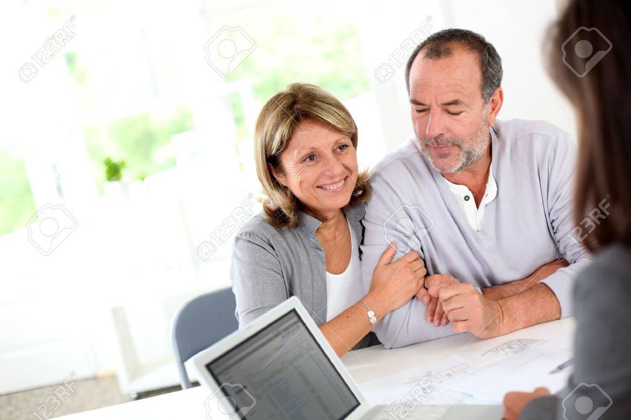 Senior couple ready to buy new house reading contract Stock Photo - 14022908