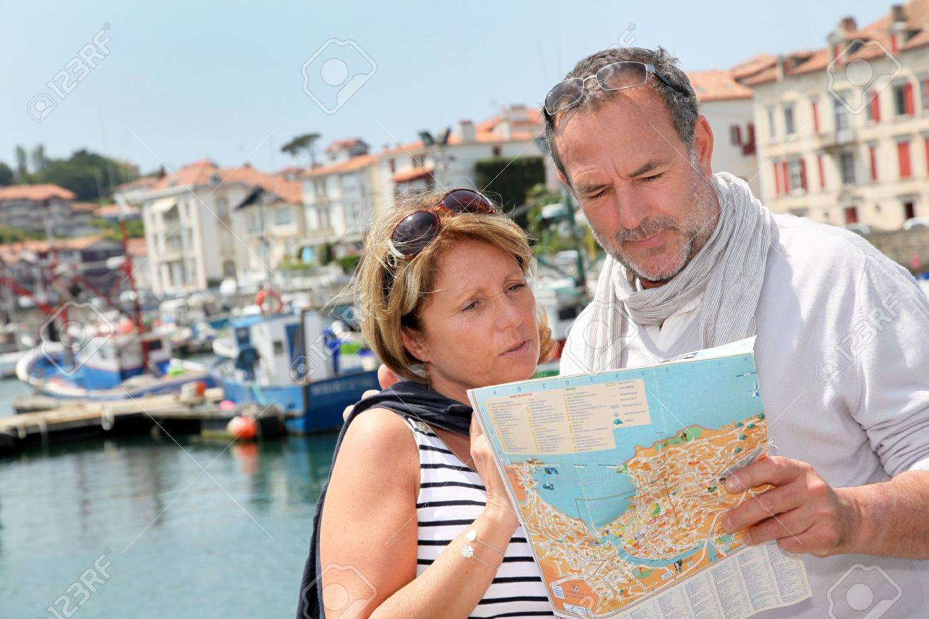 Senior couple in touristic area looking at map Stock Photo - 14024421