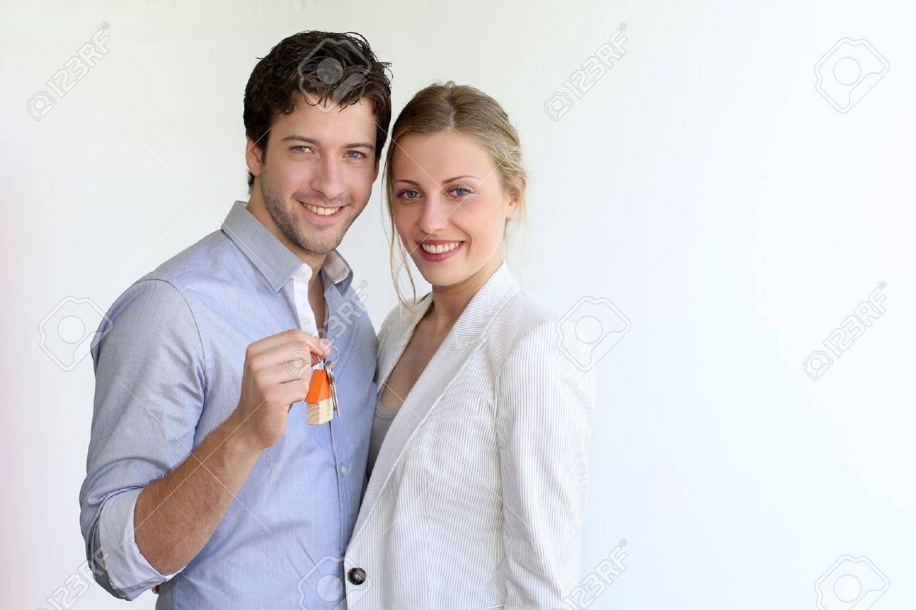 Young smiling couple holding keys of their new house Stock Photo - 14104162