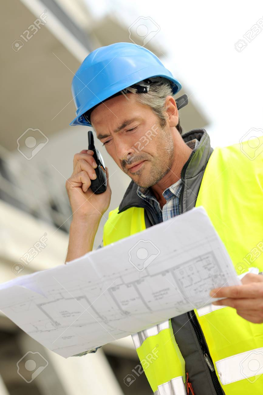 Portrait of construction manager using walkie-talkie Stock Photo - 15043084
