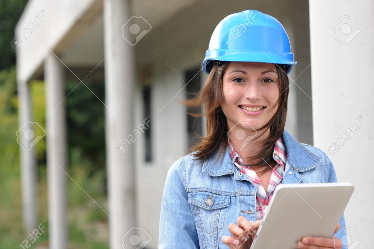 Architect on building site working with electronic tablet Stock Photo - 15043127