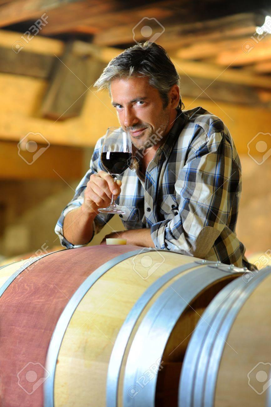 Winemaker tasting red wine in winery Stock Photo - 15088989