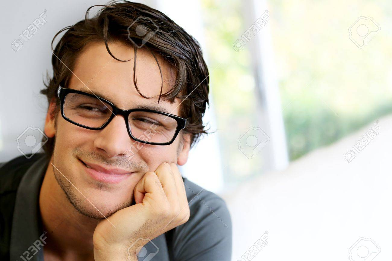256a942b07e Portrait of handsome young man with glasses Stock Photo - 15278214