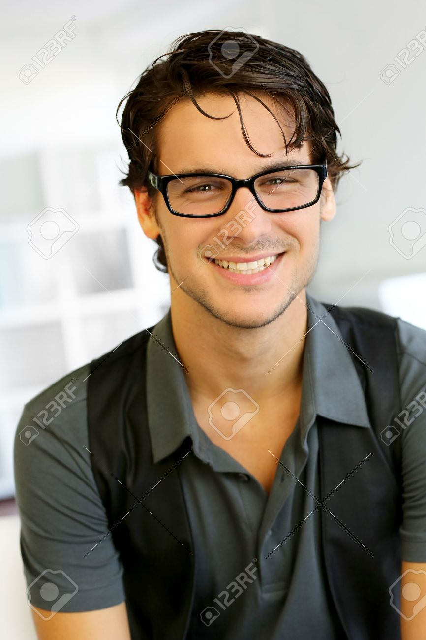 aabf6735ed2 Portrait of handsome young man with glasses Stock Photo - 15279559